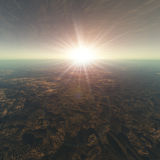 Cracked Earth Horizon Background. A cracked earth view with sun background. Bright flash and flare of over hazy sky horizon Royalty Free Stock Images