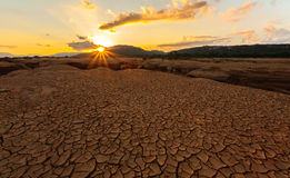 Cracked earth near drying water on twilight at Sam Pan Bok Stock Images