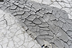 Cracked earth near mud volcanoes Stock Photos