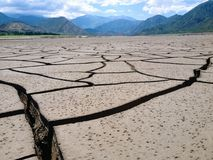 Cracked earth. This picture was taken in the dried reservoir of Potrerillos in Mendoza. Argentina. Even if it looks like a dessert royalty free stock photography
