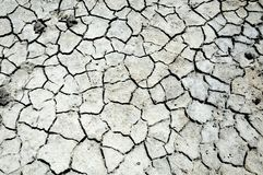 Cracked earth. saline, salt-marsh. texture. Land prone to erosion royalty free stock photos