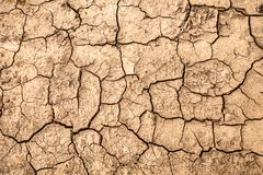 Cracked earth. Texture of cracks in the dry earth. Background wallpaper for design and creativity royalty free stock photos