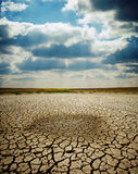 Cracked earth under dramatic sky Royalty Free Stock Photo