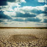 Cracked earth under dramatic sky Stock Image