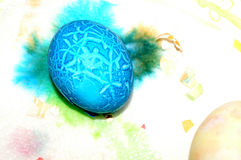 Cracked easter egg. Spots and stains and one cracked egg what remans after an easter egg dying session Royalty Free Stock Photography