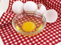 Cracked Egg on Red Stock Photos
