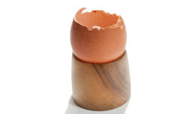 Cracked egg on the wooden holder Stock Photography