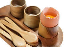 Cracked egg on the wooden holder Stock Images