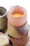 Cracked egg on the wooden holder Stock Image