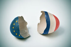 Cracked eggshell with European and French flags Stock Photo