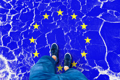 Cracked Eu flag with human legs Royalty Free Stock Photos