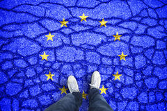 Cracked Eu flag with a man legs Royalty Free Stock Images