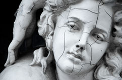 Cracked face of female Greek sculpture