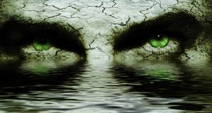 Cracked face with scary eyes. Cracked and dry skin on a man`s face, with diabolic eyes reflecting in water Stock Photos