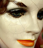 Cracked Female Mannequin Face. A creepy old mannequin face of a female with many cracks Royalty Free Stock Photography
