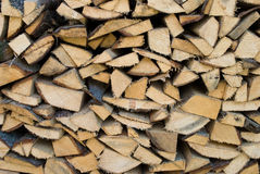 Cracked firewood. Firewood on the stock near the house Stock Photos