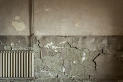 Cracked flaking paint on wall, background texture Stock Image