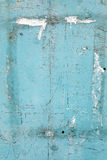 Cracked flaking paint on wall, background texture Royalty Free Stock Photography