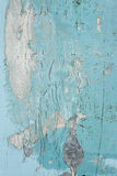 Cracked flaking paint on wall, background texture Stock Images