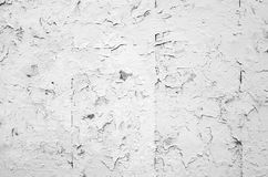 Cracked flaking white paint on old stone wall Royalty Free Stock Photography