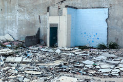 Cracked floor of destroyed building. Cracked floor of destroyed building in abandoned area Royalty Free Stock Images
