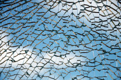 Cracked glass. Close up of broken window pane against blue sky Royalty Free Stock Images