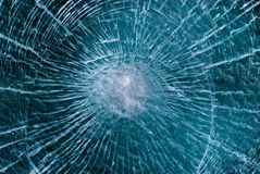 Cracked glass. Blue background of cracked glass Stock Image