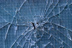 Cracked glass. Blue background of cracked glass Royalty Free Stock Image