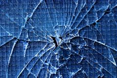 Cracked glass. Blue background of cracked glass Royalty Free Stock Images