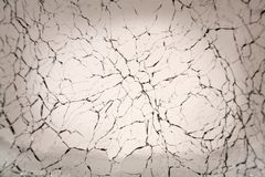 Cracked Glass Background. Background of cracked glass in warm gray tones Royalty Free Stock Images
