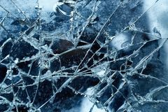Cracked glass detail. With dark background royalty free stock image