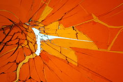 Background with broken cracked glass. Colored glass. Orange background with broken cracked glass. Colored glass Royalty Free Stock Photos
