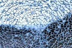 Cracked glass pane. Cracked blue glass pane, abstract background royalty free stock photos