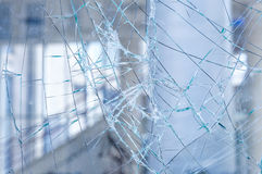 Cracked glass in a shop window closeup Royalty Free Stock Photos
