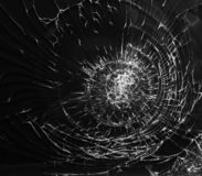 Cracked glass texture on black background royalty free stock images