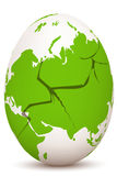 Cracked global egg Stock Photo