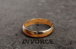 Cracked gold divorce ring royalty free stock image