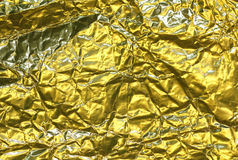 Cracked golden metallic foil, christmas background Royalty Free Stock Photos