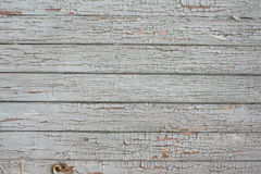 Cracked gray paint on boards background. Royalty Free Stock Photos