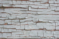 Cracked gray paint on the boards. background. Royalty Free Stock Images
