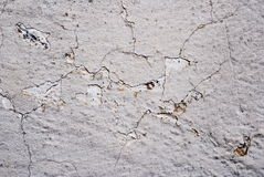 Cracked gray paint on concrete Royalty Free Stock Photos