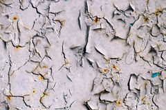 Cracked gray paint on an old metallic surface, rusted gray painted metal wall, sheet of rusty metal with cracked and flaky paint Royalty Free Stock Image