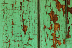 Cracked green paint wood. Wood cracked paint green door Royalty Free Stock Photos