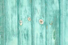 Cracked green paint on a wooden door. Blurry effects. Centered focus. Landscape orientation.  royalty free stock images