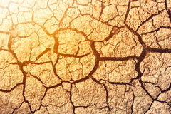Cracked ground caused by drought. Impact of global warming conce Stock Photo