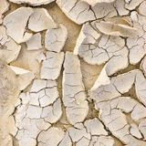 Cracked ground after drought, large detailed macro closeup, beige texture pattern Stock Photo