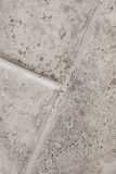 Cracked Grout. Grout that has cracked in between tiles in a home bathroom Stock Photography