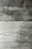 Cracked grungy cement wall Stock Image