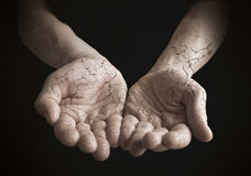 Cracked hands together on black. Royalty Free Stock Photos