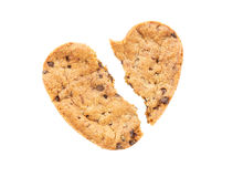 Cracked heart shaped chocolate chip cookie isolated Royalty Free Stock Photography